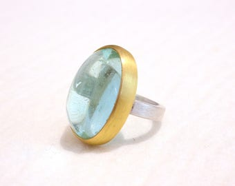 Silver and gold ring with aquamarine cabochon