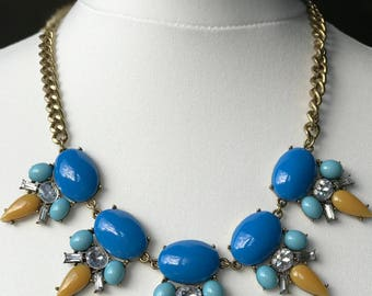 Blue and mustard yellow bib style statement necklace