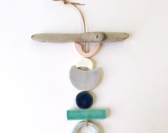 one of a kind moon meets ocean ceramic wall hanging with driftwood