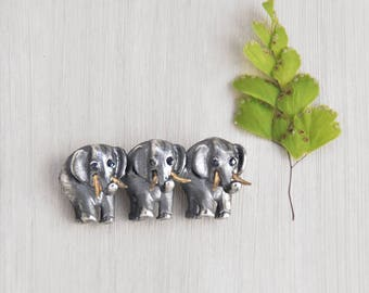 Vintage Sterling Silver Elephant Brooch - trio of pachyderms in a row pin - sapphire eyes and gold vermeil tusks