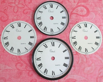 Four Vintage Paper Clock Faces