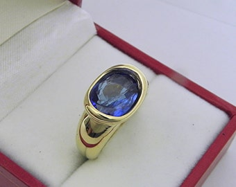 AAA  Tanzanite 2.42 carats  10.3x8mm in 14K Yellow gold bezel set ring. 0261