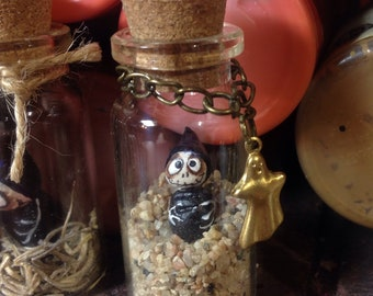 Miniature Grimmy in a bottle with ghost