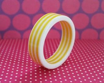 Midcentury White & Yellow Striped Lucite Bangle