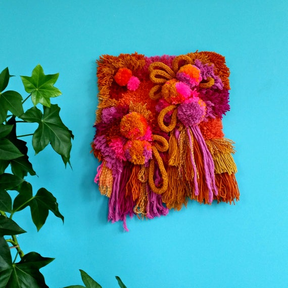 Mustard and pink pom pom wall hanging. Perfect girls room decor.