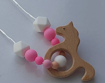 Pink and white silicone beads and wooden seahorse teething necklace