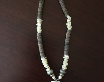 Shell Pendant on a Grey and White Necklace