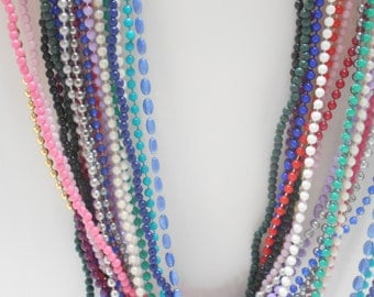 "Twenty (20) Plastic Beaded Necklaces (7481) 36"" Long"
