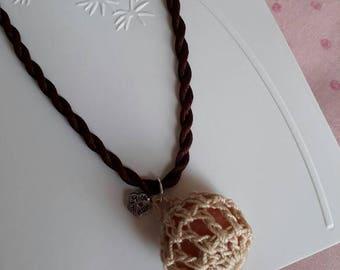 Orange calcite gem stone encased in crochet cotton hanging on a brown silk plait-ladies semi prescious stone necklace