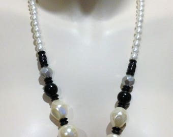 Necklace - Large  and smaller pearl and disc shaped pink beaded necklace