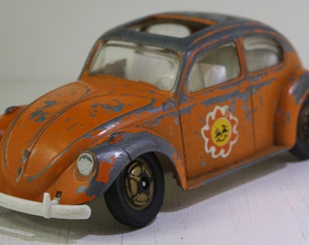 Vintage  1960's  Die Cast Hubley Orange Volkswagen Hippie  Beetle.