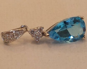 14k white gold diamond and blue topaz pendant