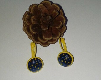 Blue yellow star and star glass cabochon earrings