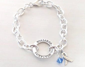 Survivor Blue Charm Bracelet Crystal Charm and Silver Awareness Ribbon Colon Cancer Arthritis Child Abuse Dystonia Reyes Syndrome