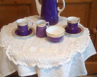 A striking purple breakfast coffee set for two.