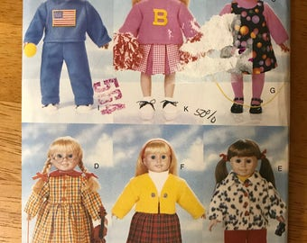 """Butterick 5604 - Doll's Back to School Wardrobe including Track Suit, Cheerleader Outfit, Dress, Jumper, Skirt, Pants, and Jacket - 18"""" Doll"""