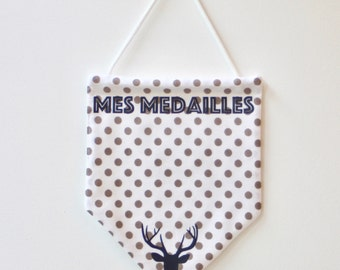 flag hanging medals of skiing with polka dots. Navy Blue - taupe - white