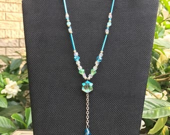 Turquoise, mint, and silver charm y necklace