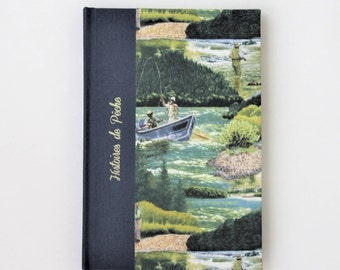 Book fishing stories with a pattern of fishermen on a river, notebook with lined pages