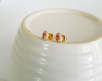 Teeny, tiny oval vintage guilloche, gold plated post earrings.
