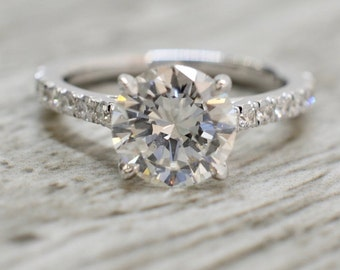 Round Brilliant in a Open Trellis French Pavé Engagement Ring in White