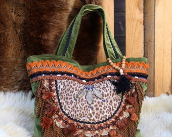 Hand bag Green Velvet, canvas leopard, trims, fringes, tassels, ethnic, bone, wood, glass beads, gold and bronze studs, bag charm.