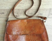 Vintage tan embossed tooled rustic leather crossbody shoulder bag