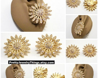 Avon Flower Crystal Sunburst Clip On Earrings Gold Tone Vintage Large Round Slotted Raised Nail Heads White Pads Crimped Petals