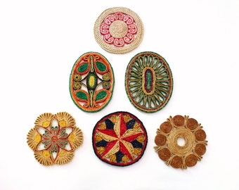 Collection of Six Colorful Woven Trivet Wall Hangings
