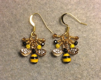 Black and yellow striped enamel and rhinestone honeybee charm earrings adorned with tiny black, yellow, and topaz Chinese crystal beads.