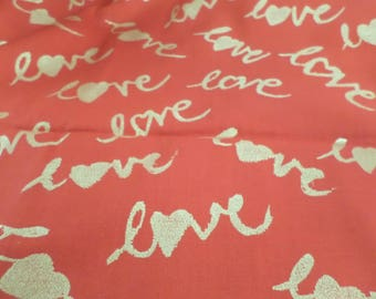 Valenstines fabric that is red with gold lettering that says love cotton fabric that is out of print and sold by the yard