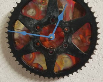 Motorcycle Sprocket clock, with torched copper backing and large blue hands