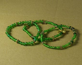 Green and gold bracelets