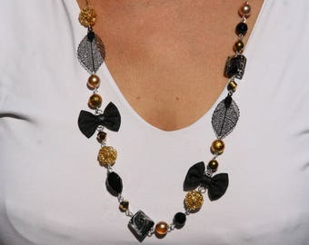 Black and gold color necklace