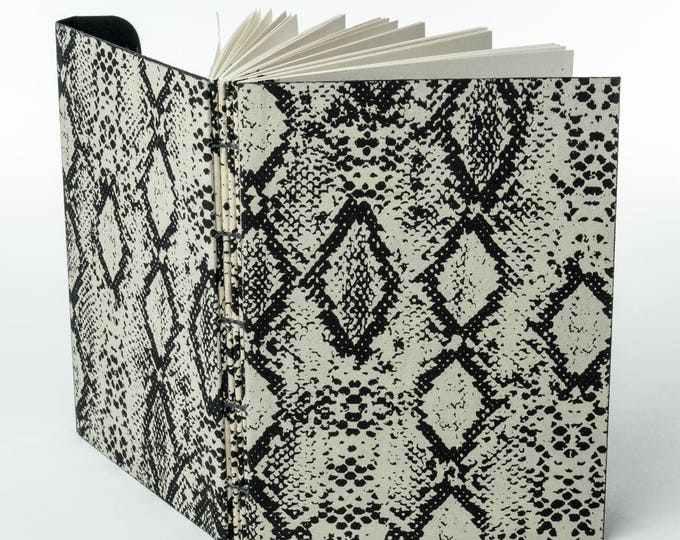 "PAPER PYTHON | 120 ~5.5x4"" blank pages w/ clasp closure 