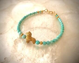bracelet with Arizona turquoise beads and solid gold 18 karat 22k