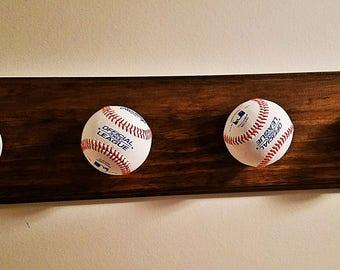 Wood hat rack with baseballs