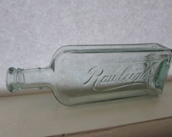 """Antique Aqua W.T. Rawleigh's Embossed Glass Bottle/ Medicine bottle has suction scar with no embossing, 1910 -1915/ 8.5"""" H"""