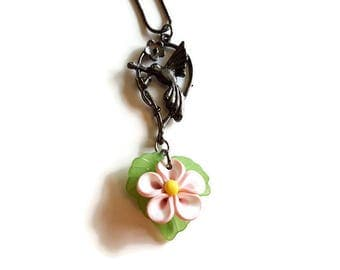 Black hummingbird and pink polymer clay flower necklace