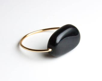 Skinny ring with black Czech glass transparent bead