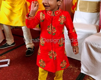 Red rawsilk hand embroidered kurta paired with yellow soft silk pants.