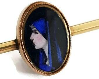 Vintage gold plated christian Limoges porcelaine brooch