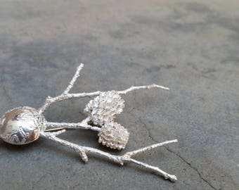Twig and seedpod brooch