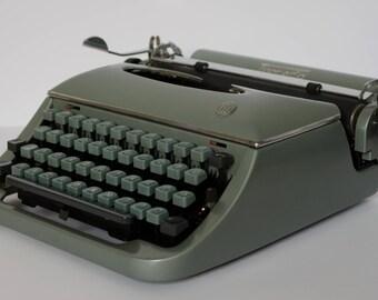 Portable typewriter Torpedo - working typewriter  with case