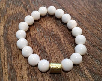 Bracelet made of bone beads with a gold bead accent