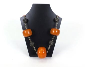 Large amber coloured bead necklace