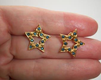 Vintage Avon blue Rhinestone Star earrings,Rhinestones,post,stud,stars,Gold tone,Pre-owned