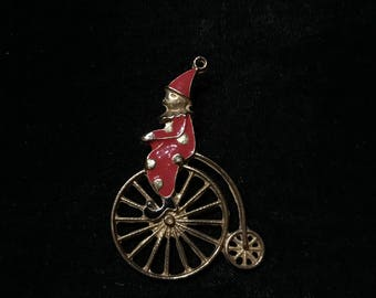 Vintage Circus clown on high wheeler bicycle enamel pin.