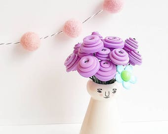 """Luna"" purple bouquet with happy lady vase"