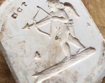 Wedgwood original vintage Jasperware plaster mould of cherub or angel archer. Collectible souvenir or paperweight, pottery memorabilia.